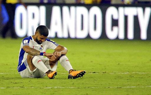 Panama's Gabriel Gomez sits on the field after the team's 4-0 loss to the United States in a World Cup qualifying soccer match, Friday, Oct. 6, 2017, in Orlando, Fla.