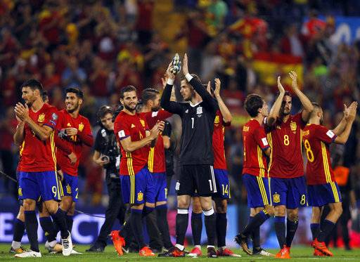 Spain players celebrate at the end of the World Cup Group G qualifying soccer match between Spain and Albania at the Rico Perez stadium in Alicante, Spain, Friday, Oct. 6, 2017. Spain won 3-0 and qualified for the 2018 tournament finals.