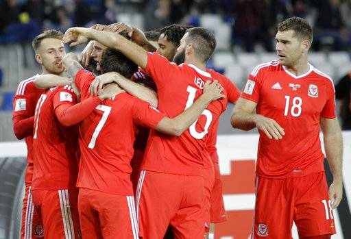 Wales' players celebrate after scoring the opening goal during the World Cup Group D qualifying soccer match between Georgia and Wales at the Boris Paichadze Dinamo Arena in Tbilisi, Georgia, Friday, Oct. 6, 2017.