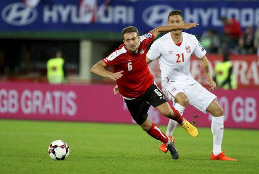 Austria's Stefan Ilsanker, left, challenges Serbia's Nemanja Matic for the ball during the World Cup Group D qualifying soccer match between Austria and Serbia at the Ernst Happel Stadium in Vienna, Austria, Friday, Oct. 6, 2017.