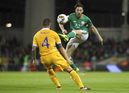 Ireland's Harry Arter, right, and Moldova's Petru Racu battle for the ball during the 2018 World Cup qualifying, group D match at the Aviva Stadium, Dublin, Ireland, Friday Oct. 6, 2017. (Niall Carson/PA via AP)