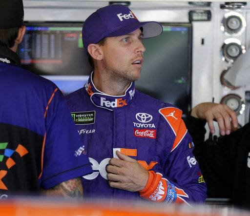 Denny Hamlin looks from the garage before practice for Sunday's NASCAR Cup Series auto race at Charlotte Motor Speedway in Concord, N.C., Friday, Oct. 6, 2017.