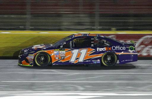 Denny Hamlin drives his car during qualifying for Sunday's NASCAR Cup Series auto race at Charlotte Motor Speedway in Concord, N.C., Friday, Oct. 6, 2017. Hamlin won the pole position for the race.