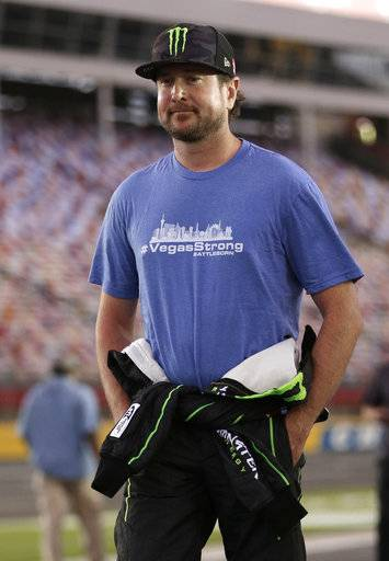 Kurt Busch, of Las Vegas, wears a #VegasStrong T-shirt as he walks down pit road before qualifying for Sunday's NASCAR Cup Series auto race at Charlotte Motor Speedway in Concord, N.C., Friday, Oct. 6, 2017.