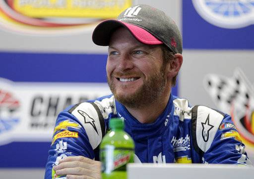 Dale Earnhardt Jr. smiles at members of various sports teams from his former high school during a news conference after practice for Sunday's NASCAR Cup Series auto race at Charlotte Motor Speedway in Concord, N.C., Friday, Oct. 6, 2017. The track donated $100,000 to Carolinas HealthCare Systems for concussion testing and research in Earnhardt's name.