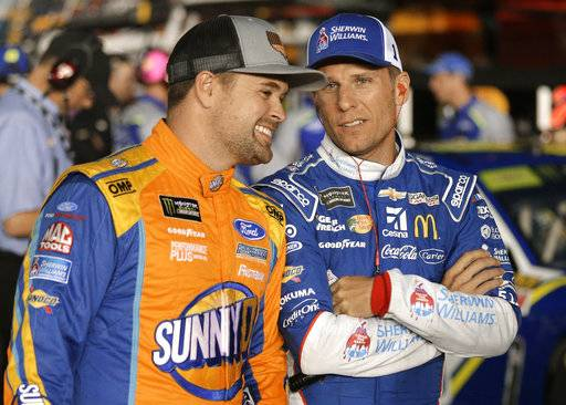 Jamie McMurray, right, talks with Ricky Stenhouse Jr. before qualifying for Sunday's NASCAR Cup Series auto race at Charlotte Motor Speedway in Concord, N.C., Friday, Oct. 6, 2017.