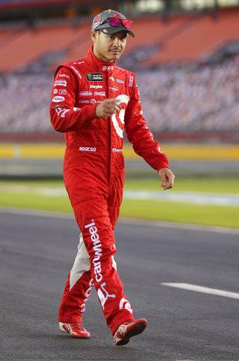 Kyle Larson walks down pit road before qualifying for Sunday's NASCAR Cup Series auto race at Charlotte Motor Speedway in Concord, N.C., Friday, Oct. 6, 2017.