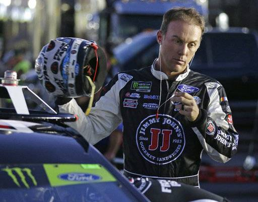 Kevin Harvick prepares to climb into his car before qualifying for Sunday's NASCAR Cup Series auto race at Charlotte Motor Speedway in Concord, N.C., Friday, Oct. 6, 2017.