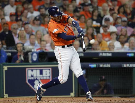 Houston Astros' Carlos Correa hits a two-run home run against the Boston Red Sox during the first inning in Game 2 of baseball's American League Division Series, Friday, Oct. 6, 2017, in Houston.