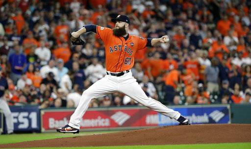 Houston Astros starting pitcher Dallas Keuchel (60) delivers a pitch against the Boston Red Sox during the first inning in Game 2 of baseball's American League Division Series, Friday, Oct. 6, 2017, in Houston.