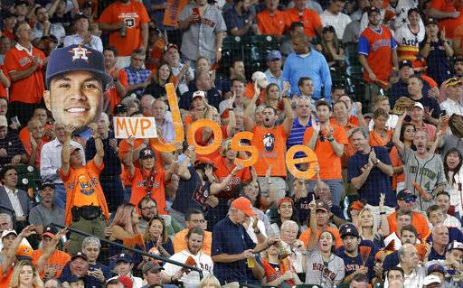 Fans cheer for Houston Astros second baseman Jose Altuve (27) during the first inning in Game 2 of baseball's American League Division Series against the Boston Red Sox, Friday, Oct. 6, 2017, in Houston.