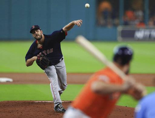 Boston Red Sox starting pitcher Drew Pomeranz delivers a pitch against Houston Astros during the first inning in Game 2 of baseball's American League Division Series, Friday, Oct. 6, 2017, in Houston. (Ronald Martinez/AP, Pool)