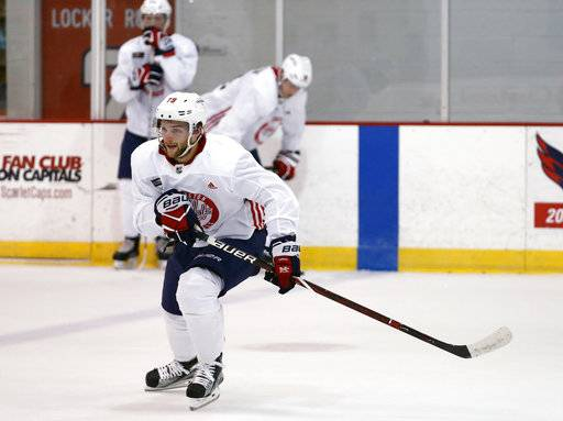 FILE - In this Sept. 15, 2017, file photo, Washington Capitals' Nathan Walker practices in Arlington, Va. Walker is set to become the first Australian player to dress in an NHL game when he makes his debut Saturday night, Oct. 7, 2017, against the Montreal Canadiens.