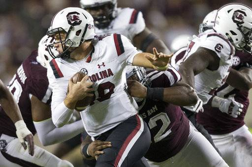 South Carolina quarterback Jake Bentley (19) is sacked by Texas A&M defensive lineman Zaycoven Henderson (92) during the fourth quarter of an NCAA college football game Saturday, Sept. 30, 2017, in College Station, Texas.