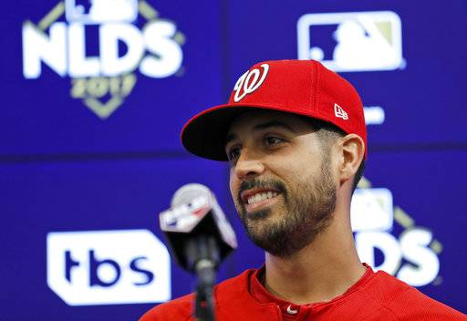 Washington Nationals starting pitcher Gio Gonzalez smiles during a media availability before Game 1 of baseball's National League Division Series, at Nationals Park, Friday, Oct. 6, 2017, in Washington. Gonzalez is scheduled to start Game 2 for the Nationals.