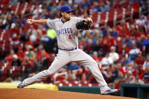 FILe - In this Sept. 27, 2017, file photo, Chicago Cubs starting pitcher John Lackey throws during the first inning of a baseball game against the St. Louis Cardinals, in St. Louis. Lackey is on the reigning World Series champion Cubs' roster for their NL Division Series against the Washington Nationals. Lackey was not among the starting pitchers that Cubs manager Joe Maddon had announced for the NLDS that begins in Washington on Friday night, so his status was in doubt.
