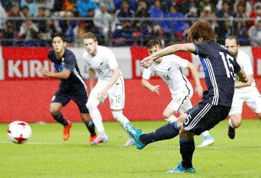Japan's Yuya Osako, front right, scores a goal in the last half during a friendly soccer match against New Zealand in Toyota, central Japan Friday, Oct. 6, 2017. (Naoya Osato/Kyodo News via AP)