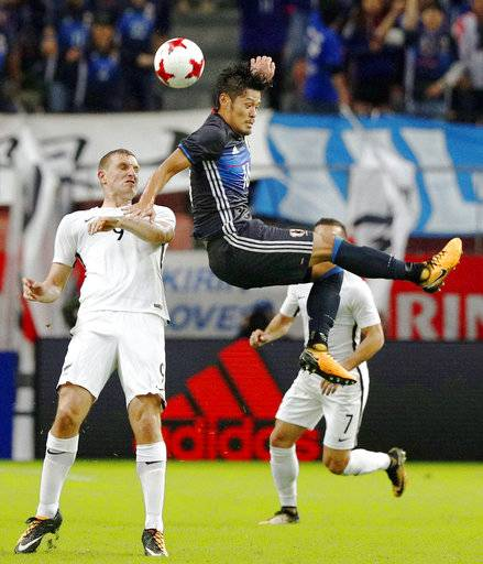 Japan's Hotaru Yamaguchi, front right, vies for the ball with New Zealand's Shane Smeltz in the first half during their friendly soccer match in Toyota, central Japan Friday, Oct. 6, 2017. (Yuta Omori/Kyodo News via AP)