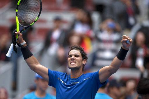 Rafael Nadal of Spain celebrates after defeating John Isner of the United States during a men's singles quarterfinal match of the China Open tennis tournament held at the Diamond Court in Beijing, China, Friday, Oct. 6, 2017.