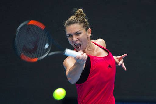 Simon Halep of Romania returns a shot from Daria Kasatkina of Russia during a women's singles quarterfinal match of the China Open tennis tournament held at the Diamond Court in Beijing, China, Friday, Oct. 6, 2017.
