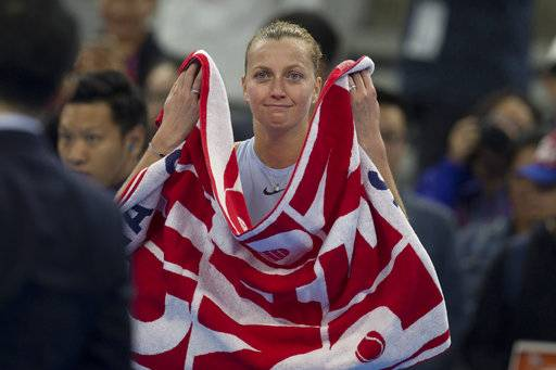 Petra Kvitova of the Czech Republic reacts after defeating Barbora Strycova of the Czech Republic during a women's singles quarterfinal match in the China Open tennis tournament at the Diamond Court in Beijing, China, Friday, Oct. 6, 2017.