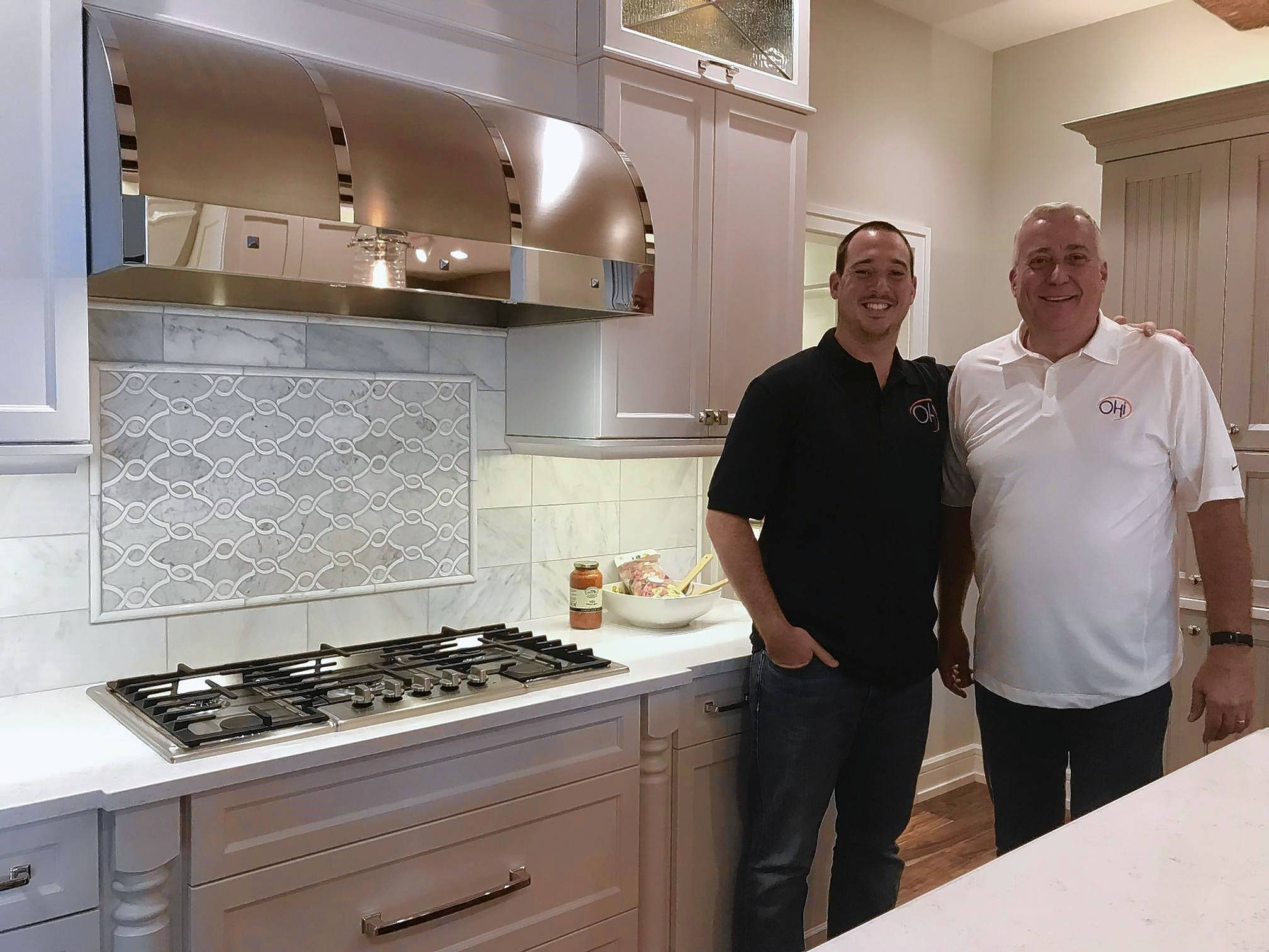"John Kautz, right, and his nephew, Nick Kautz Jr., founded OHi, short for ""Our Home Improvement,"" a home remodeling company based in Elk Grove Village."