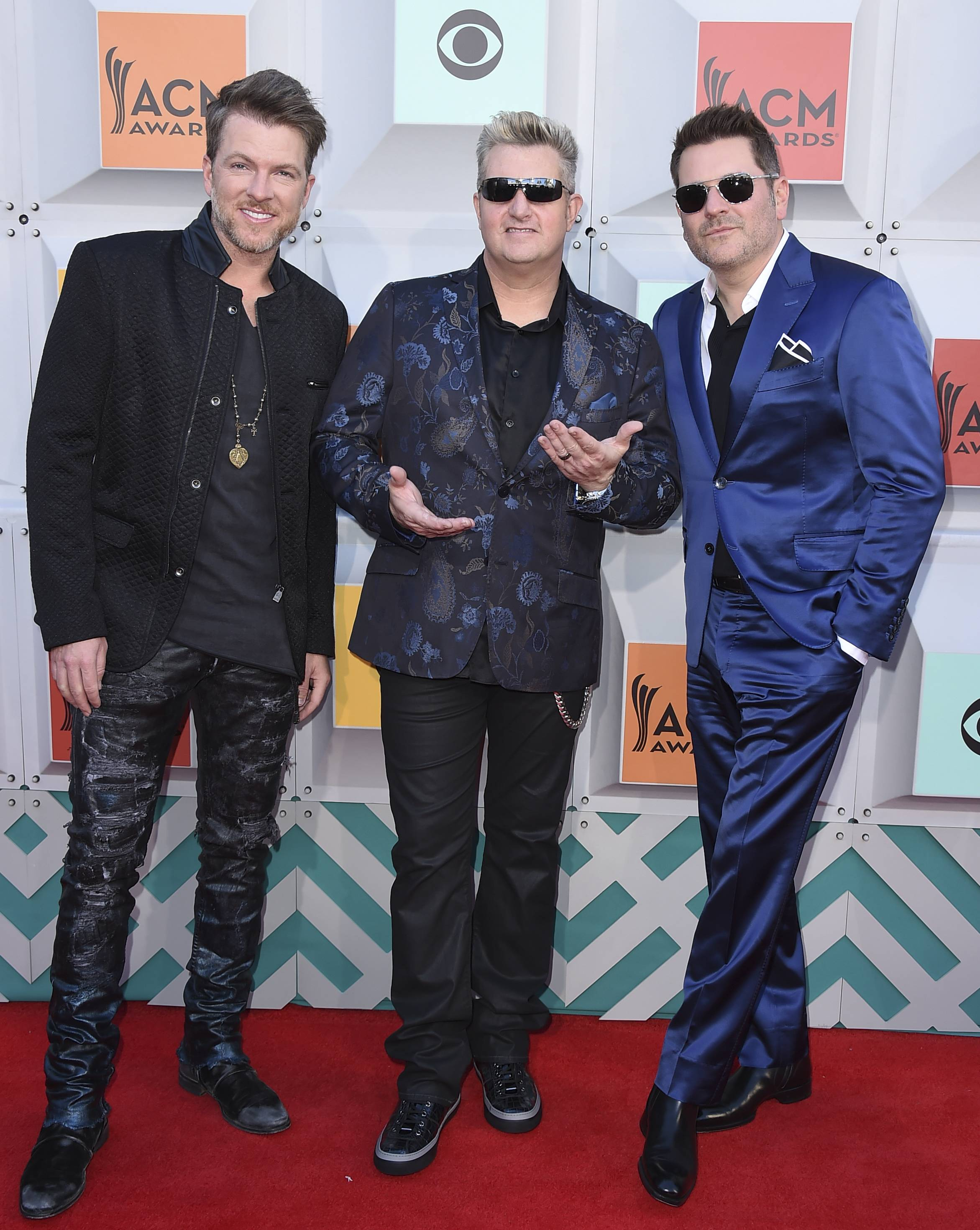 Joe Don Rooney, from left, Gary LeVox, and Jay DeMarcus, of Rascal Flatts, arrive at the 51st annual Academy of Country Music Awards in Las Vegas in 2016.