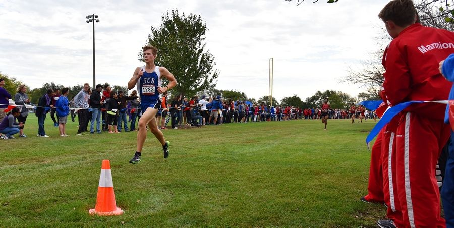 The first St. Charles North finisher was Bojan Ruttens, who placed 14th overall Saturday at the West Aurora Stampede cross country invitational at Stuarts Sports Complex in Aurora.