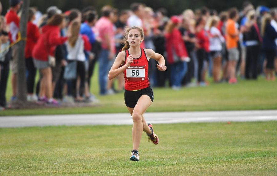Batavia's Mia Gianfrancesco strides to a second-place finish Saturday at the West Aurora Stampede cross country invitational at Stuarts Sports Complex in Aurora.