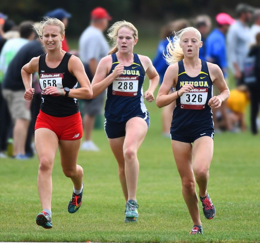 Neuqua Valley's Julia Rushine, right, and teammate Keara Ginell, middle both catch and pass a fading Nicole Greyer, of Yorkville, to place 6th and 7th overall Saturday at the West Aurora Stampede cross country invitational at Stuarts Sports Complex in Aurora.