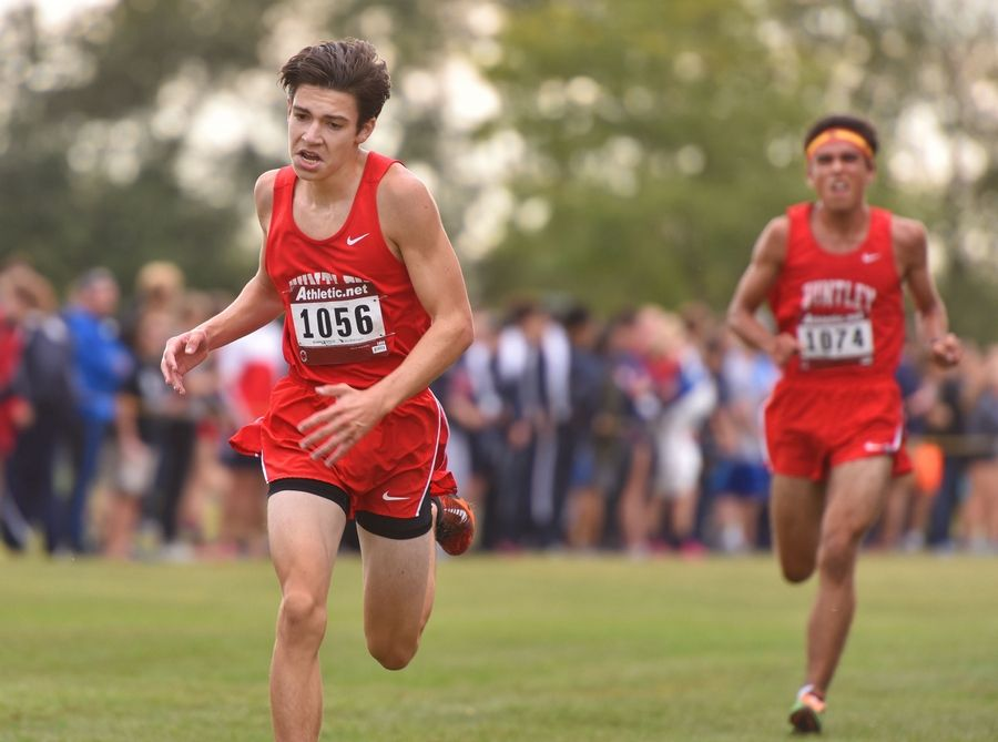 Huntley's Ian Geisler places sixth overall while teammate Josh Segura follows him to the finish for eighth place overall Saturday at the West Aurora Stampede cross country invitational at Stuarts Sports Complex in Aurora.
