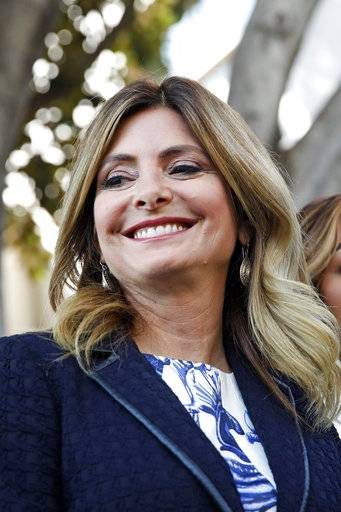 "FILE - In this July 10, 2017 file photo, attorney Lisa Bloom stands outside a courthouse in downtown Los Angeles.  Bloom says she is no longer representing movie mogul Harvey Weinstein as he confronts sexual harassment allegations. Bloom posted Saturday, Oct. 7,  on Twitter that she has resigned as an adviser to Weinstein. She added that he and his board of directors are, quote, ""moving toward an agreement."