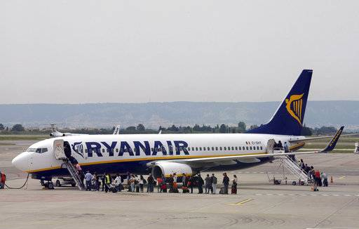 FILE- In this Wednesday, May 13, 2015 file photo passengers disembark a Ryanair plane, at the Marseille Provence airport, in Marignane, southern France. The chief operations officer of Ryanair announced Saturday, Oct. 7, 2017, plans to leave his post at the end of October, following the cancellation of tens of thousands of flights scheduled for the coming months.