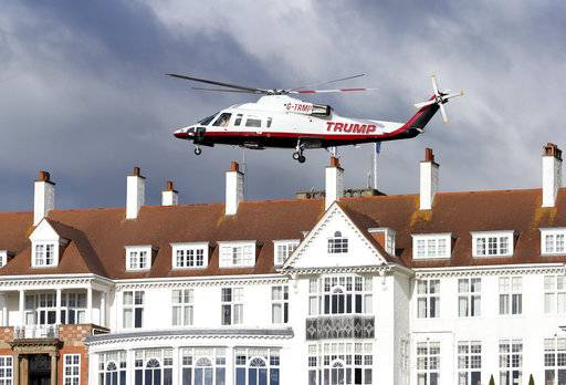 FILE - In this July 29, 2015 file photo, a helicopter owned by Donald Trump departs from the Turnberry golf course in Turnberry, Scotland,  A financial report filed with the British government shows Donald Trump is losing millions for a third year in a row on a couple of his biggest investments: his Scottish golf resorts. A report from Britain's Companies House shows losses last year at the two resorts more than doubled to 17.6 million pounds ($23 million). Revenue also fell sharply. The company attributed the results partly to having shut down its Turnberry resort for half the year while fixing up a course.