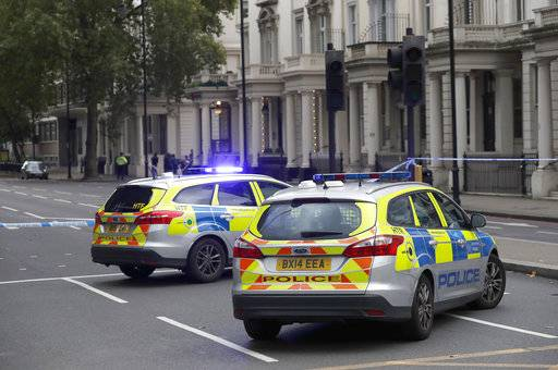 Britain's police cars at the scene of an incident in central London, Saturday, Oct. 7, 2017. London police say emergency services are outside the Natural History Museum in London after a car struck pedestrians.