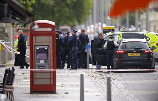 Britain's Police at the scene of an incident in central London, Saturday, Oct. 7, 2017. London police say emergency services are outside the Natural History Museum in London after a car struck pedestrians.