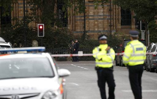 Britain's policemen stand at the scene of an incident in central London, Saturday, Oct. 7, 2017. London police say emergency services are outside the Natural History Museum in London after a car struck pedestrians.