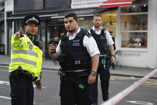 Britain's policemen at the scene of an incident in central London, Saturday, Oct. 7, 2017. London police say emergency services are outside the Natural History Museum in London after a car struck pedestrians.