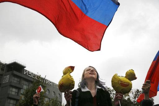 Demonstrators shout slogans during a rally in Moscow, Russia, Saturday, Oct. 7, 2017. Opposition leader Alexei Navalny has worked to organize protests in support of his presidential bid across Russia on Saturday, President Vladimir Putin's birthday.
