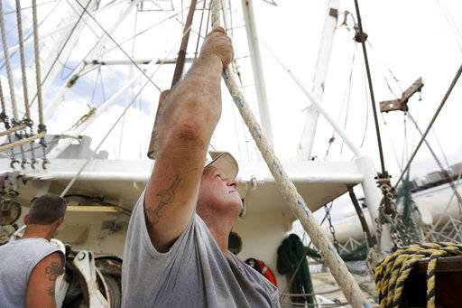 "Boat hand Wayne Hall helps to secure the boat ""Jeraline"" in Bayou La Batre, Ala., on Saturday, Oct. 7, 2017, ahead of Hurricane Nate, expected to make landfall on the Gulf Coast later in the day."