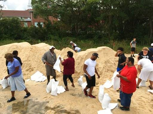 People fill sandbags to prepare for Hurricane Nate in Moss Point, Miss., on Saturday, Oct. 7, 2017. Storm surge threatens many low-lying neighborhoods in city, which was heavily flooded during 2005's Hurricane Katrina.
