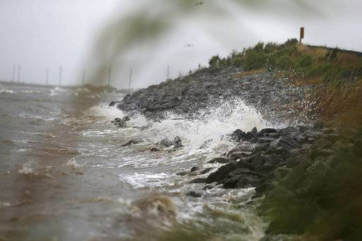 Gulf Coast waves crash against rocks as winds continue to speed up in Coden, Ala., on Saturday, Oct. 7, 2017, ahead of Hurricane Nate, expected to make landfall on the Gulf Coast later in the day.