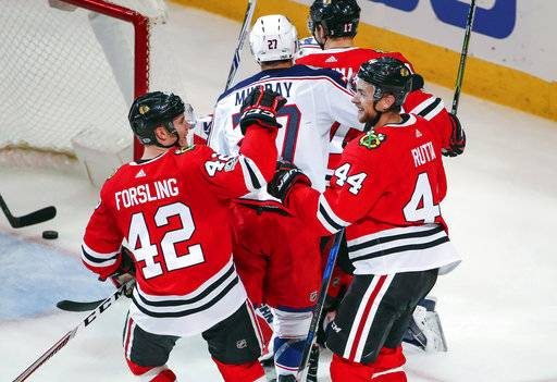Chicago Blackhawks defenseman Jan Rutta (44) is congratulated by defenseman Gustav Forsling (42) after scoring against the Columbus Blue Jackets during the second period of an NHL hockey game Saturday, Oct. 7, 2017, in Chicago.