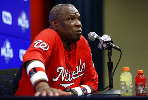 Washington Nationals manager Dusty Baker listens to a question during a media availability before Game 2 of baseball's National League Division Series against the Chicago Cubs, at Nationals Park, Saturday, Oct. 7, 2017, in Washington.