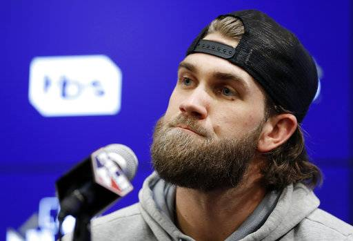 Washington Nationals right fielder Bryce Harper listens to a question during a media availability before Game 2 of baseball's National League Division Series against the Chicago Cubs, at Nationals Park, Saturday, Oct. 7, 2017, in Washington.