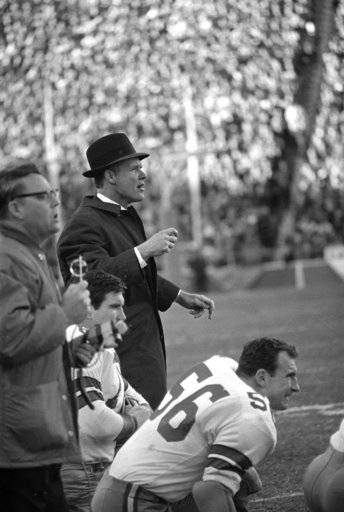 FILE - In this Jan. 1, 1967, file photo, Dallas Cowboys coach Tom Landry shouts to his players on the field during the NFL championship game against the Green Bay Packers in Dallas. The Packers won 34-27. Packers-Cowboys has been one of the NFL's most entertaining and meaningful rivalries for decades.