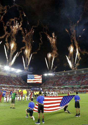 Fireworks explode over Orlando City Stadium during the U.S. national anthem before the team's World Cup qualifying soccer match against Panama, Friday, Oct. 6, 2017, in Orlando, Fla. The United States won 4-0.