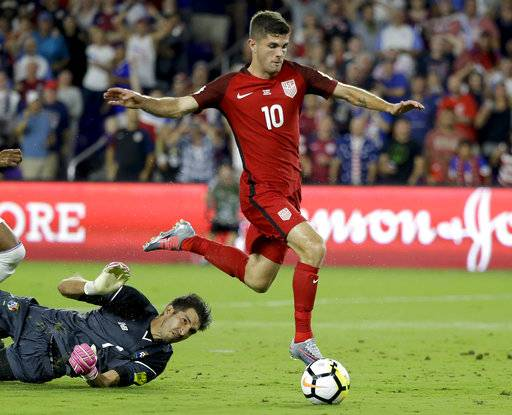 United States' Christian Pulisic (10) gets past Panama goalkeeper Jaime Penedo (1) to score a goal during the first half of a World Cup qualifying soccer match, Friday, Oct. 6, 2017, in Orlando, Fla.