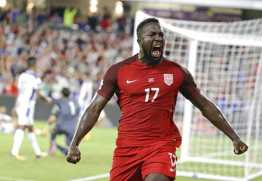 United States' Jozy Altidore celebrates in front of fans after scoring a goal against Panama during the first half of a World Cup qualifying soccer match, Friday, Oct. 6, 2017, in Orlando, Fla.