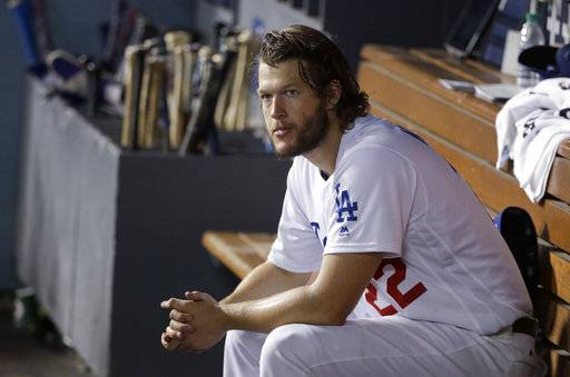 Los Angeles Dodgers starting pitcher Clayton Kershaw sits on the bench after being removed during the seventh inning of Game 1 of the baseball team's National League Division Series against the Arizona Diamondbacks in Los Angeles, Friday, Oct. 6, 2017.